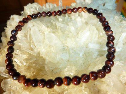 Bracelet protection extreme: Oeil de taureau perles rondes 4 mm